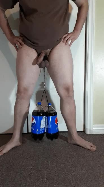 Pepsi bottle challange starter. How many can your testicals lift