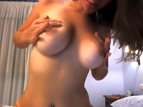 Big natural busty girl spits on her boobs gif