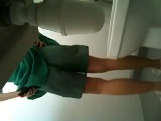 Cute Schoolgirl using toilet