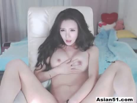 Cute Asian cam girl playing with self