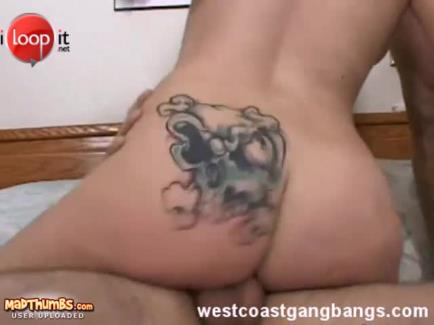 Tattooed dame riding on cock in close up shoot