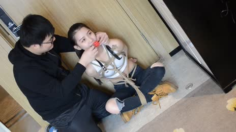 Asian model tied up with ballgag