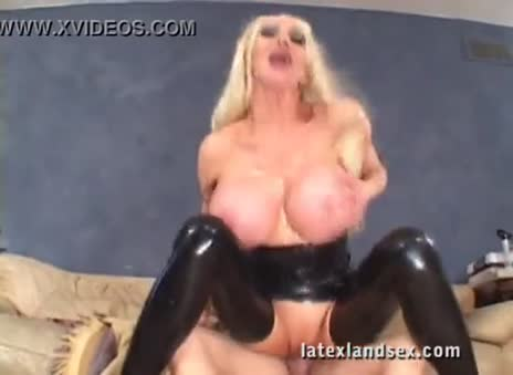 Sexbabe in latex boots riding cock